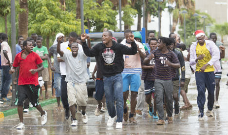Migrants jump Spain-Morocco border fence in heavy rain