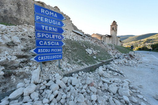 Italy 'on its knees' after biggest earthquake in 30 years