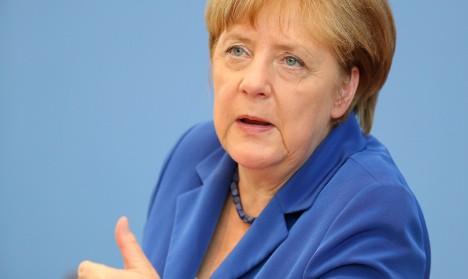Merkel rallies German industry to take tough line on Brexit