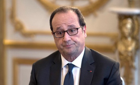 Hollande struggles to put out fires from new tell-all book