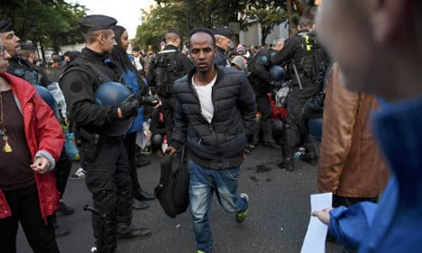 Police move in on swelling migrant camp in Paris