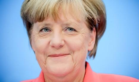 Merkel seeks new term 'to defend democratic values'