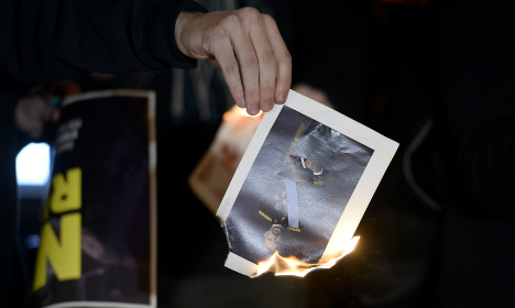 Five Catalans who burned photos of Spanish king arrested