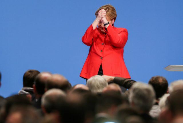 Merkel re-elected as CDU party leader with big majority