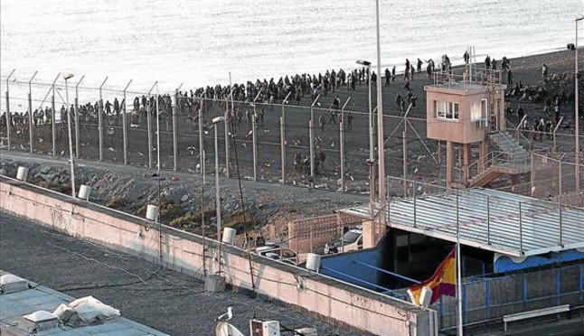 Nearly 400 migrants storm border at Spanish enclave of Ceuta