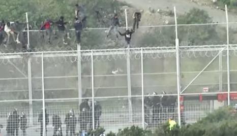 1,100 migrants storm border fence at Spain's Ceuta enclave