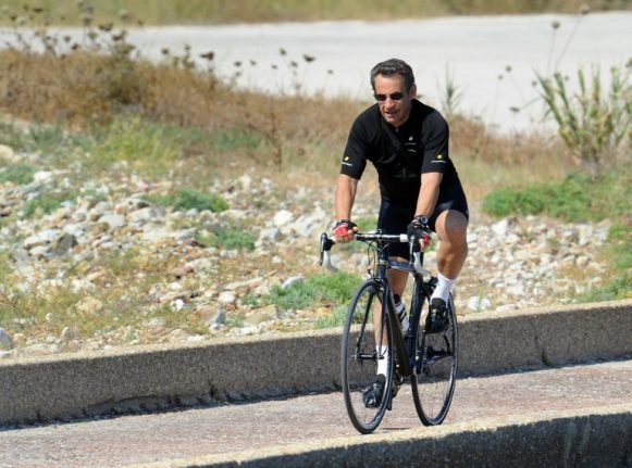 Police catch Sarkozy cycling on wrong side of the road