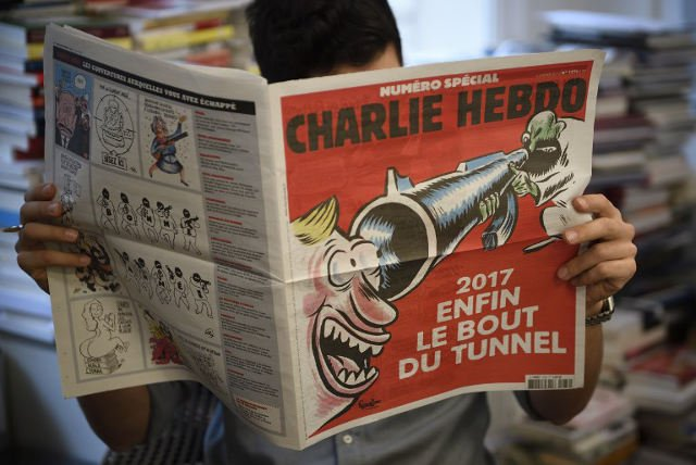 Charlie Hebdo marks attack anniversary with black humour