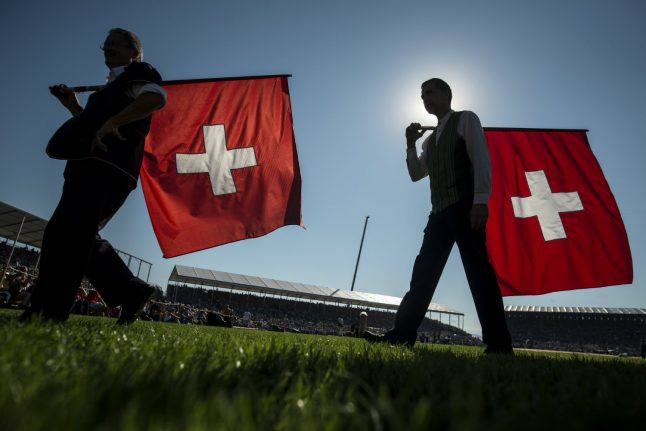 Switzerland votes on citizenship measure after anti-Muslim campaign