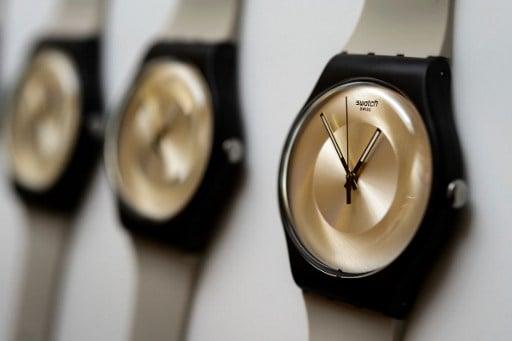 Swatch optimistic despite sharp drop in profits