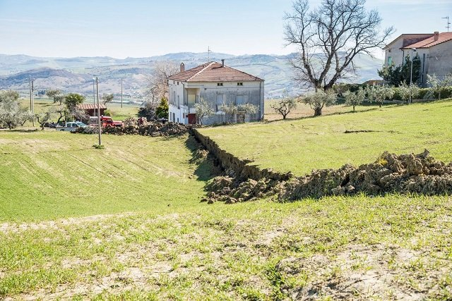 IN PICTURES: The Italian village being torn in two by a landslide no-one can stop