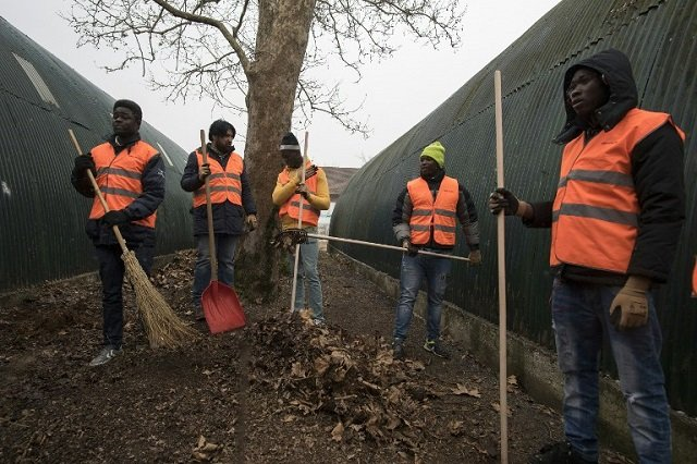 How Italy is getting asylum seekers to help out in their new communities