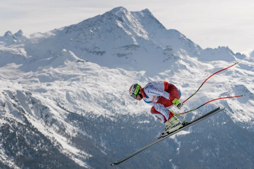 Swiss skier Feuz takes gold on home soil