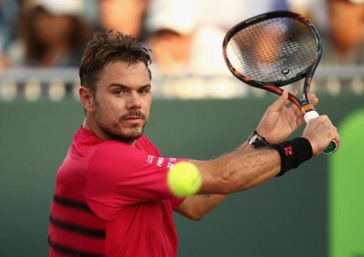 Wawrinka loses in Miami as Federer battles through to quarters