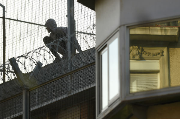 Prisoner stages 10 hour protest on roof of Barcelona jail