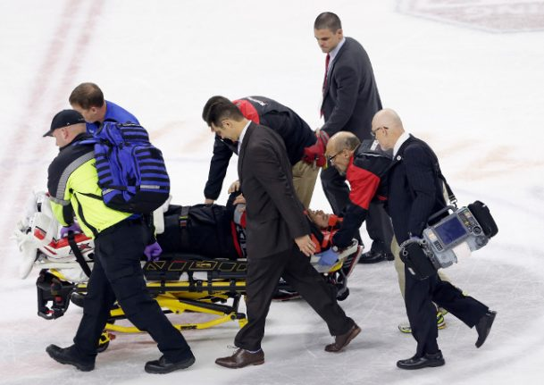 Scary pictures of Eddie Läck stretchered off ice after violent collision