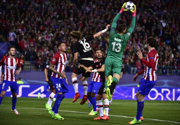 Clean-sheet masters Atletico Madrid reach Champions League quarter-finals