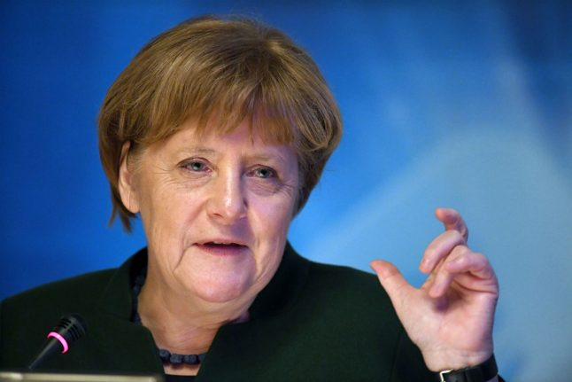 Merkel heads to North Africa to talk business and refugees