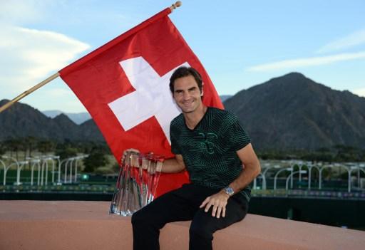 Federer triumphs over Wawrinka in all-Swiss final