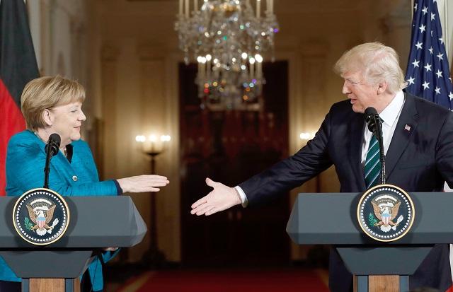 Trump 'did not refuse to shake Merkel's hand', says spokesperson