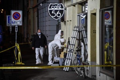 Police hunt gunmen after two shot dead in Basel cafe