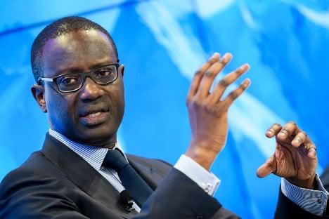 Credit Suisse execs take 40 percent bonus cuts after outcry