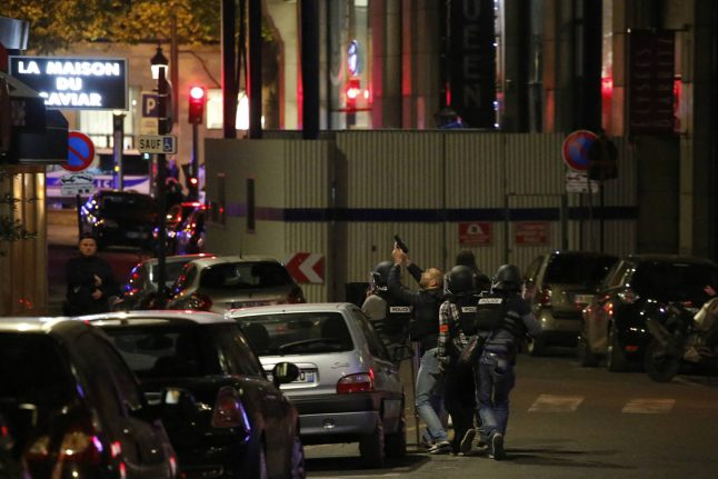 Champs Elysees attacker's father 'threatens' French police
