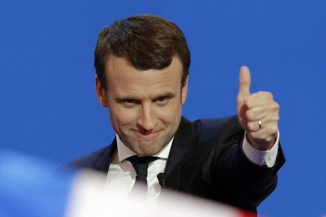 German centrists cheer on Macron into French election second round