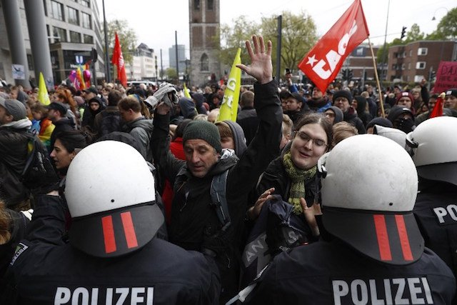 Clashes as German anti-immigration party AfD stages showdown