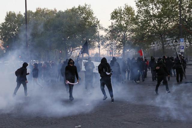 Scores arrested in violent Paris election night protests