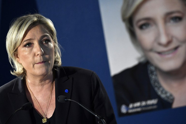 Marine Le Pen accused of 'exploiting' Champs-Elysées attack