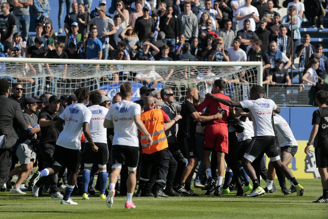 VIDEO: French football shamed as fans attack players on pitch