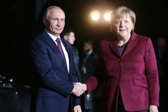 Merkel makes rare Russia visit as Putin backs warmer ties