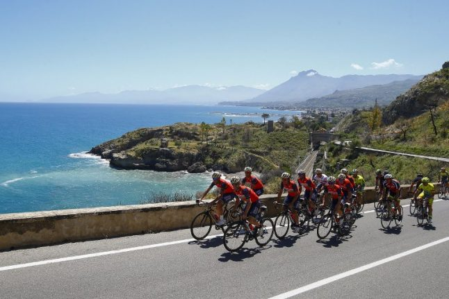 Giro d'Italia cyclists race to Mount Etna summit