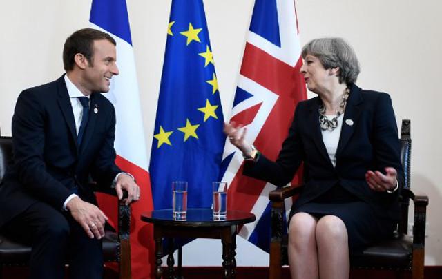 Buoyant Macron hosts weakened Theresa May in Paris for hard talks on Brexit
