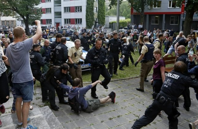 Hundreds of students clash with police over deportation of Afghan classmate