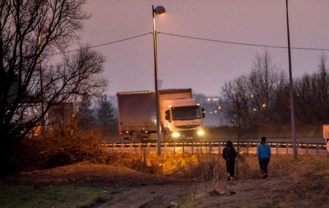 Calais: Van driver killed in crash caused by migrants' motorway road block