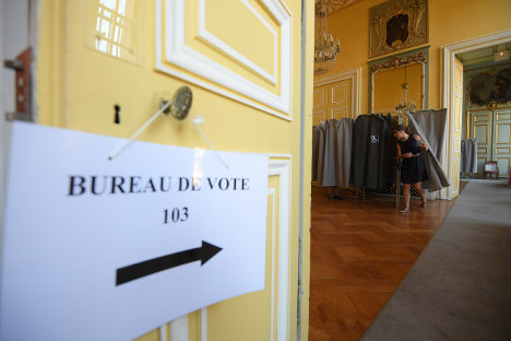 Macron seeks majority as France votes for new parliament