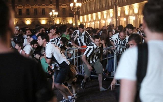 Italian woman dies after being crushed in football stampede