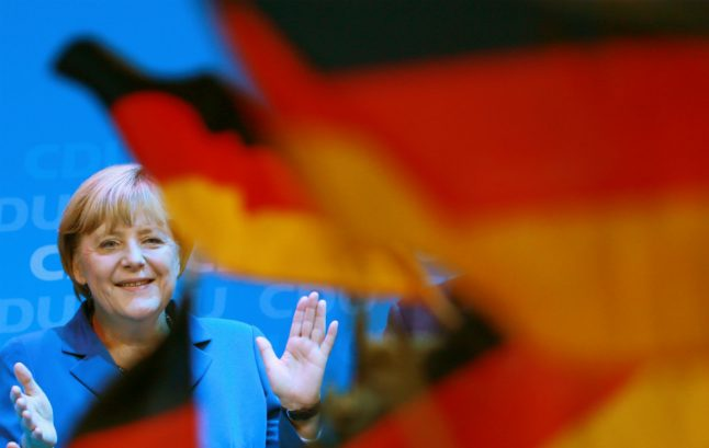 Merkel campaigns with German flag to steal a march on nationalists