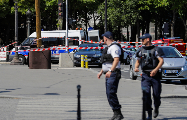 Champs-Elysées attacker had arms permit despite being on terror watchlist