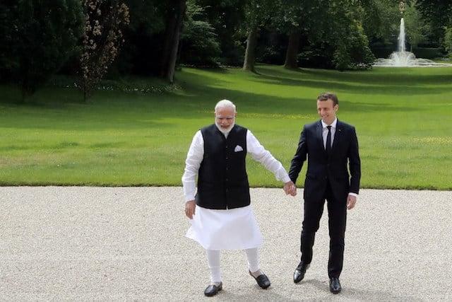 Modi tells Macron India will 'go beyond' Paris climate accord