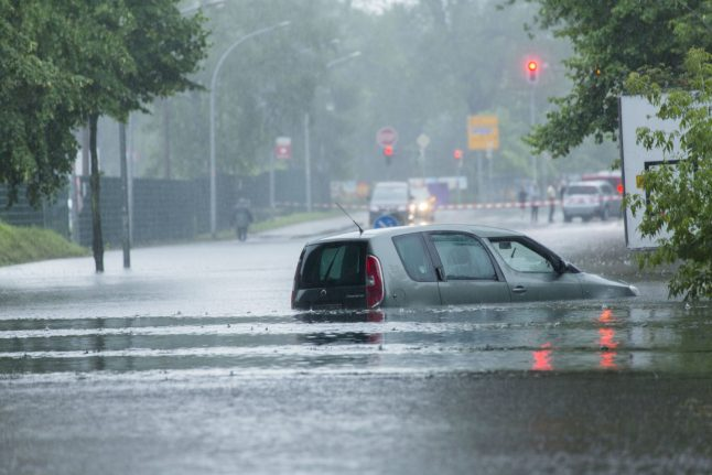 Berlin firefighters work to tackle flooding after 'heaviest rain in a century'