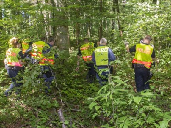 Walker discovers charred body in woods