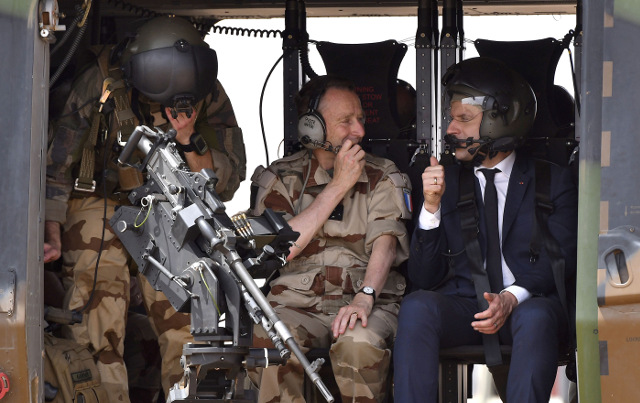 Macron visits French air base hoping to smooth over crisis with military