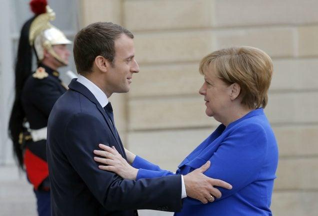 Merkel and Macron put defence at heart of blooming ties