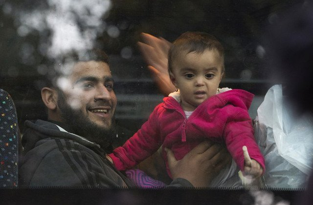 First Syrian refugees arrive in France under deal with Christian groups