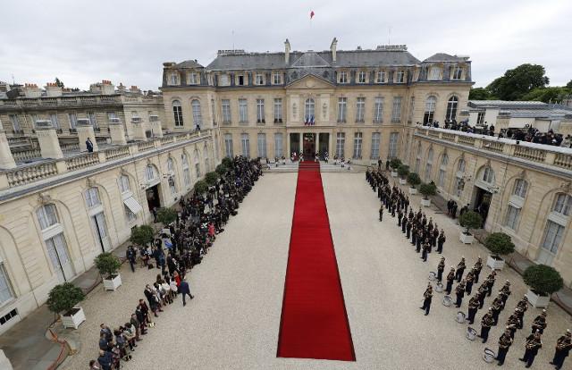 Bulletproof screens, snipers and haute cuisine: Paris prepares for Trump's visit