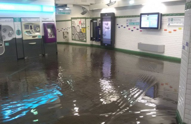 Torrential rain pounds Paris leaving Metro stations and roads flooded