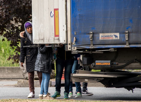 Toddler among 26 migrants found in refrigerated lorry